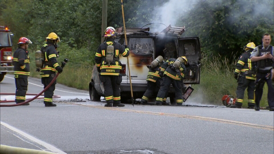 Police and fire crews responded to this torched van in a rural area of Langley on June 26, 2018.
