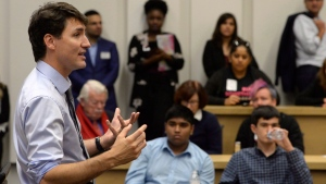 Prime Minister Justin Trudeau speaks with high school students about artificial intelligence at the University of Toronto in Toronto on Thursday Oct. 26, 2017. (THE CANADIAN PRESS/Nathan Denette)
