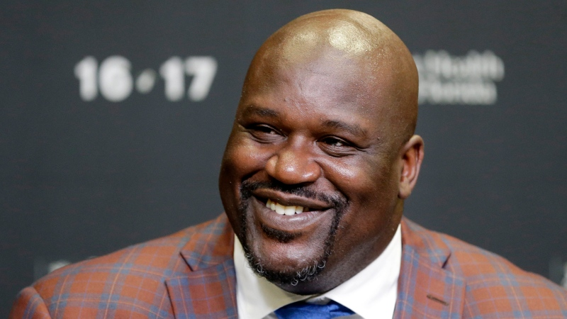 "In this Dec. 22, 2016, file photo, retired Hall of Fame basketball player Shaquille O'Neal smiles as he talks to reporters during an NBA basketball news conference in Miami. O'Neal stars in the basketball comedy, ""Uncle Drew."" (AP Photo/Alan Diaz, File)"