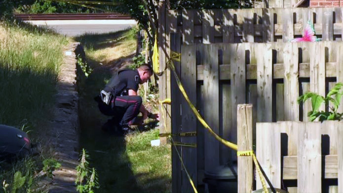 Police investigate the murder of Ronald Chandler at 926 Courtland Avenue East in Kitchener.