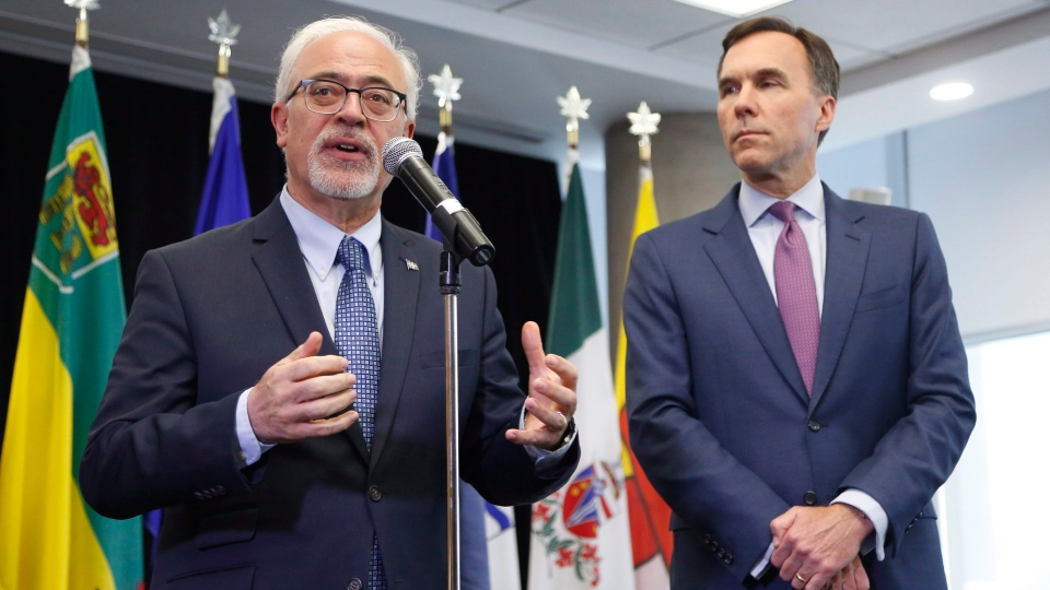 Quebec Finance Minister Carlos Leitao, left, and Finance Minister Bill Morneau speak to reporters after a meeting with provincial and territorial finance ministers in Ottawa on Tuesday, June 26, 2018. (THE CANADIAN PRESS/ Patrick Doyle)