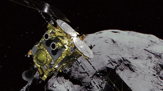 This computer graphics image provided by the Japan Aerospace Exploration Agency (JAXA) shows an asteroid and asteroid explorer Hayabusa2. (JAXA via AP)