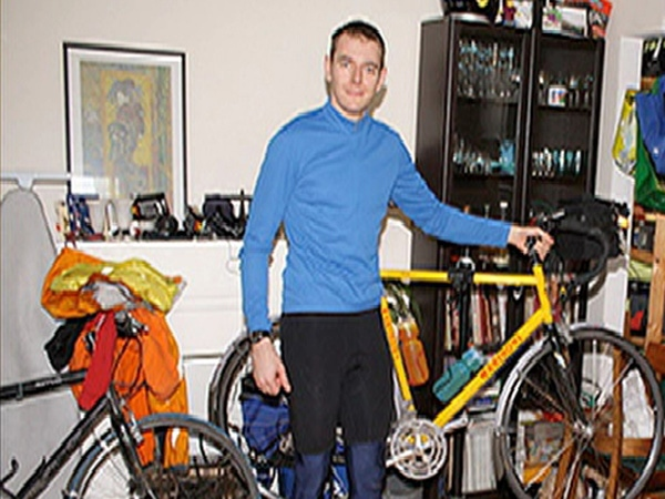 Daniel Hughes poses with his yellow bike, which was found tied to a tree in North Vancouver after his disappearance. June 13, 2009. (CTV)