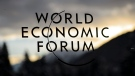 The World Economic Forum logo is pictured through a window on the eve of the opening of the Annual Meeting of the World Economic Forum, WEF, in Davos, Switzerland, Tuesday, Jan. 19, 2016. (Jean-Christophe Bott/Keystone via AP)