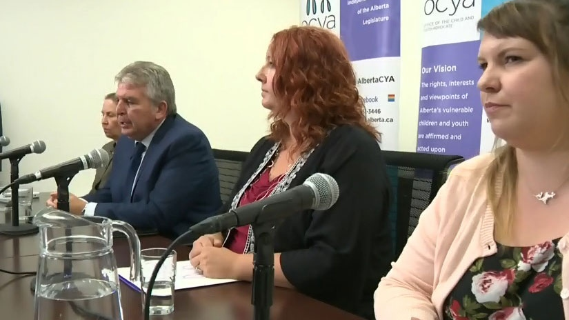 Del Graff, second from left, talks to reporters during the release of his Into Focus report into youth opioid deaths.