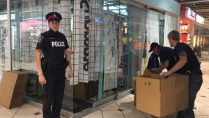 York Regional Police officers conduct a series of raids at stores inside Markham's Pacific Mall on June 27, 2018.