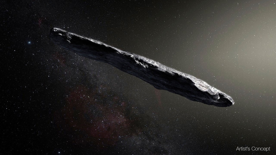 """This artist's rendering provided by the European Southern Observatory shows the interstellar object named """"Oumuamua"""" which was discovered on Oct. 19, 2017 by the Pan-STARRS 1 telescope in Hawaii. (M. Kornmesser/European Southern Observatory via AP)"""