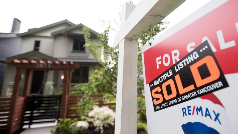 A real estate sign is pictured in Vancouver on June 12, 2018. (Jonathan Hayward/ THE CANADIAN PRESS)