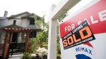 A real estate sign is pictured in Vancouver on June 12, 2018. THE CANADIAN PRESS / Jonathan Hayward