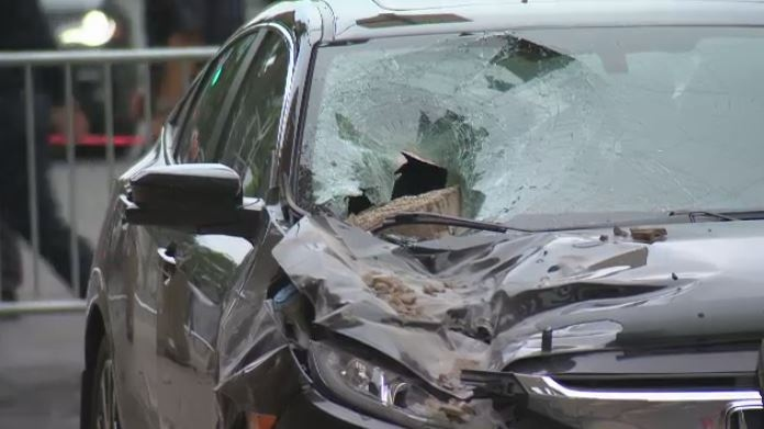 A brick damaged a car on Park Ave. Wednesday afternoon.