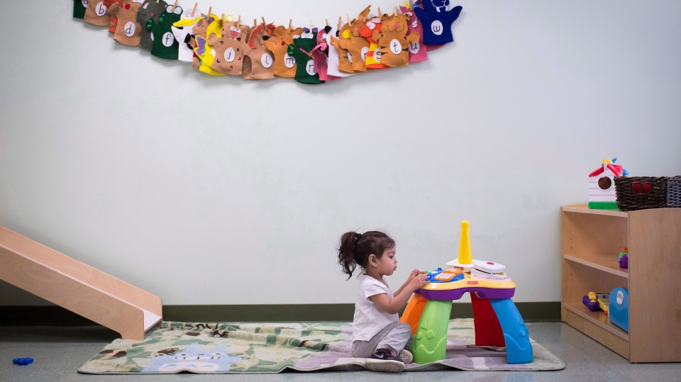 A young girl plays at a CEFA (Core Education and Fine Arts) Early Learning daycare franchise, in Langley, B.C., on Tuesday May 29, 2018. THE CANADIAN PRESS/Darryl Dyck