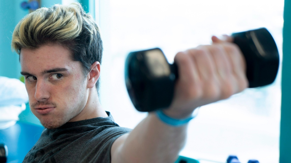 Humboldt Broncos survivor Ryan Straschnitzki does muscles strengthening exercises during a physiotherapy session at the Shriners Hospital in Philadelphia on Monday, June 25, 2018. THE CANADIAN PRESS/Paul Chiasson