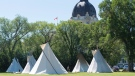 Teepees are seen at the Justice for Our Stolen Children camp near the Saskatchewan Legislative Building in Regina on Wednesday June 27, 2018. (THE CANADIAN PRESS/Michael Bell)