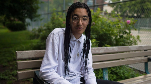 Noah Brown, a grade 12 student from Etobicoke School of the Arts, poses for a photo at Sorauren Park in Toronto on Thursday, June 28, 2018. Students from a Toronto school are calling for the resignation of a principal who created a list of black students to track their performance. THE CANADIAN PRESS/ Tijana Martin