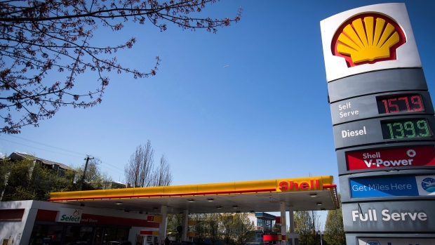 FILE -- The price of a litre of gasoline of $1.579, an all-time high for the city, is displayed on a sign as motorists fuel up at a Shell gas station in Vancouver, B.C., on Sunday April 22, 2018. (THE CANADIAN PRESS/Darryl Dyck)