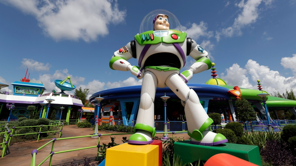 Buzz Lightyear stands near the entrance to the Aliens Swirling Saucers ride at Toy Story Land in Disney's Hollywood Studios at Walt Disney World in Lake Buena Vista, Fla.(John Raoux/ AP Photo)