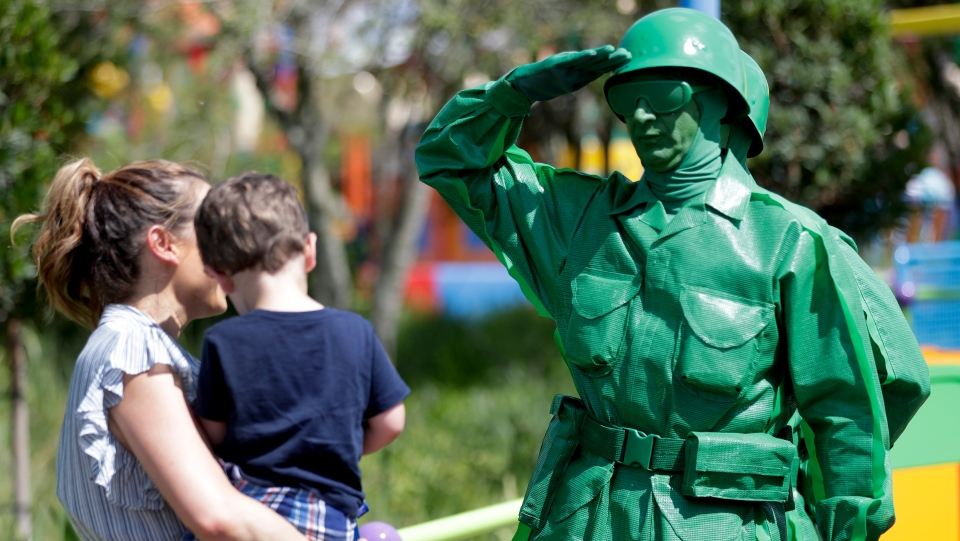 A Green Army man interacts with guests at Toy Story Land. (AP Photo/John Raoux)