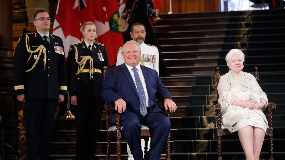 Doug Ford is sworn in as premier of Ontario as Lt.-Gov. Elizabeth Dowdeswell (right) looks on during a ceremony at Queen's Park in Toronto on Friday, June 29, 2018. THE CANADIAN PRESS/Mark Blinch