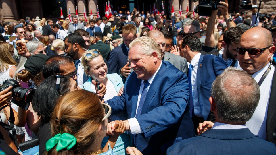 Doug Ford greets people after he is sworn in as premier of Ontario during a ceremony at Queen's Park in Toronto on Friday, June 29, 2018. (THE CANADIAN PRESS/Mark Blinch)