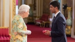 Aditya Mohan speaks with Queen Elizabeth II is a handout photo. (THE CANADIAN PRESS/HO-HM The Queen and British Ceremonial Arts Ltd.)