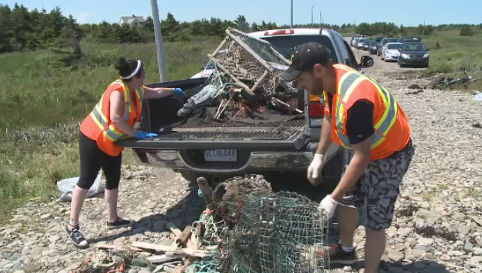 On Saturday the community came together to collect lobster traps, broken fishing gear, and trash of all kinds from the shores of Schooner Pond Beach in Donkin.