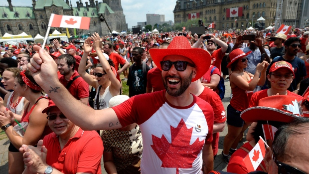 People cheer during Canada Day celebrations on Parliament Hill in Ottawa on Sunday, July 1, 2018. THE CANADIAN PRESS/Justin Tang