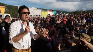 Prime Minister Justin Trudeau addresses the crowd at a Canada Day barbecue in Dawson City, Yukon, on July 1, 2018. (Darryl Dyck / THE CANADIAN PRESS)