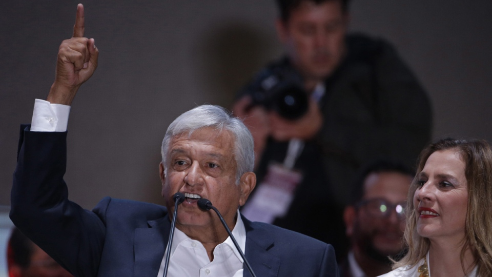 Andres Manuel Lopez Obrador, with his wife Beatriz Gutierrez Muller, delivers his victory speech in Mexico City, on July 1, 2018. (Moises Castillo / AP