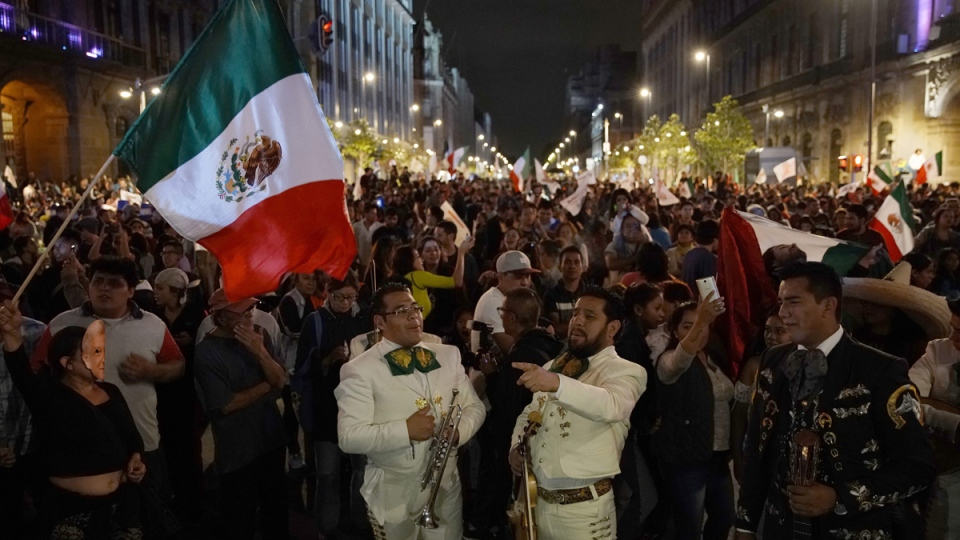 Thousands of supporters of presidential candidate Andres Manuel Lopez Obrador celebrate his victory, on Mexico City's Madero avenue, on July 1, 2018. (Ramon Espinosa / AP)