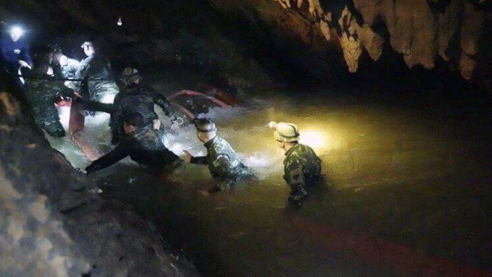 Thai rescue teams walk inside the Mae Sai cave complex in Chiang Rai, Thailand, on July 2, 2018.  (Tham Luang Rescue Operation Center via AP)