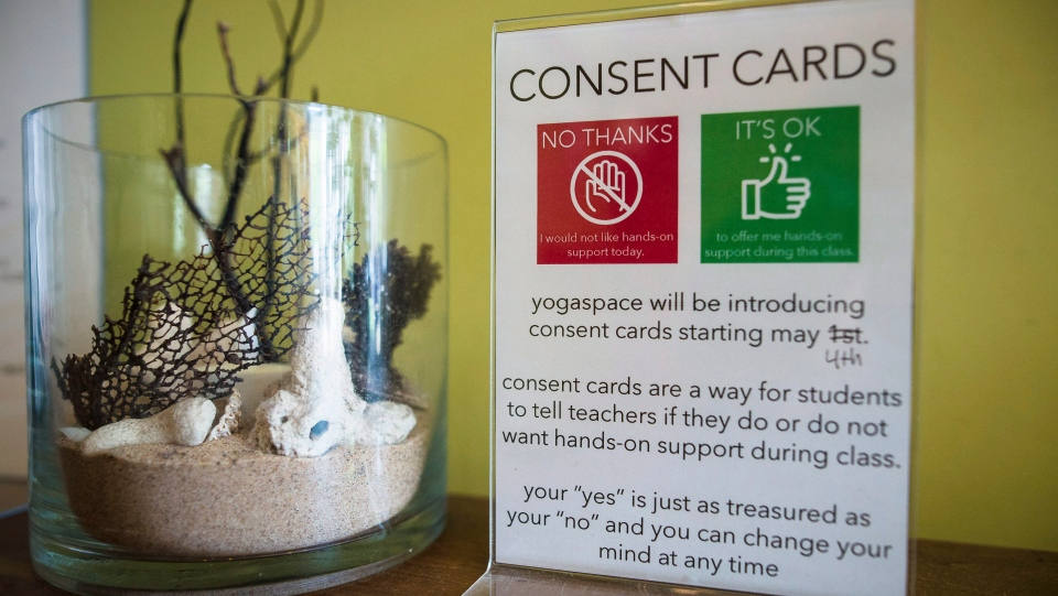 A display notice on how consent cards are used at Yogaspace in Toronto is photographed on Thursday, June 28, 2018. THE CANADIAN PRESS/ Tijana Martin