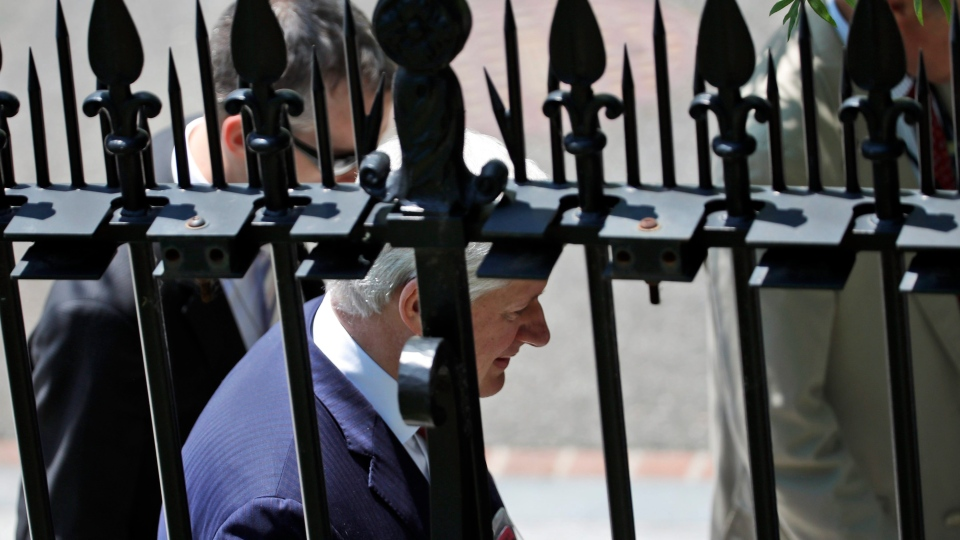Former Canadian prime minister Stephen Harper departs the West Wing of the White House, Monday, July 2, 2018, in Washington. (AP Photo/Alex Brandon)