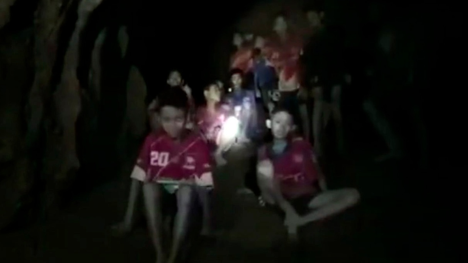 In this grab taken from video provided by the Thai Navy Seal, a view of the boys and their soccer coach as they are rescued in a cave, in Chiang Rai in Thailand, Monday, July 2, 2018.  (Thai Navy Seal via AP)