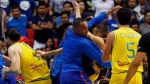 The Philippines and Australian basketball players react, during the FIBA World Cup Qualifiers at the Philippine Arena in suburban Bocaue township, Bulacan province north of Manila, Philippines on Monday, July 2, 2018. (AP Photo/Bullit Marquez)