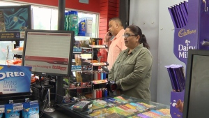 Store owners Paul and Bhagwant Chauhan are seen in the Reddi Mart in Spruce Grove, Alta. (CTV Edmonton)