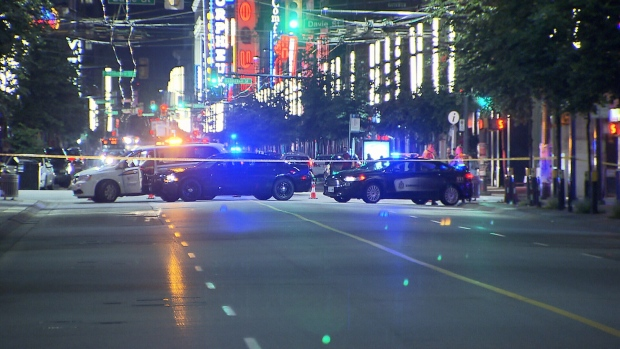 Police vehicles are seen blocking Granville Street during an incident in 2018.