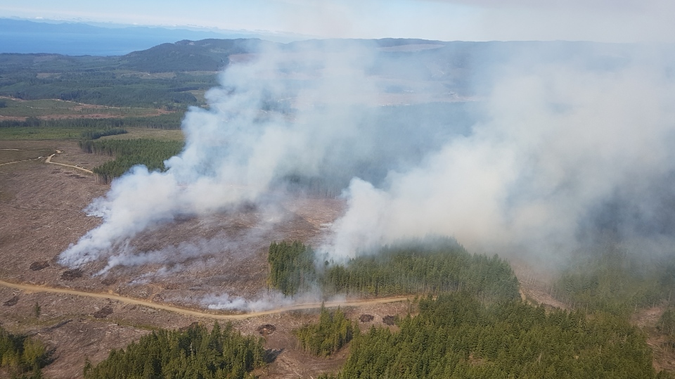 An aerial view of a fire burning near Tugwell Creek that has grown to 25 hectares. July 4, 2018. (Coastal Fire Centre)