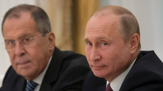 Vladimir Putin, right, and Sergey Lavrov