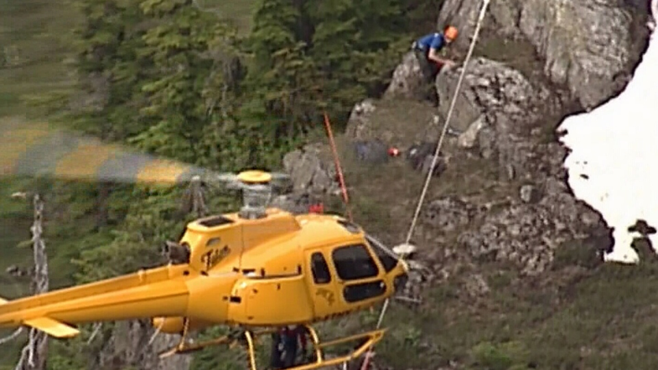Emergency crews pulled off a daring rescue after a father and daughter found themselves trapped on the side of Mount Harvey.