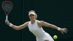 Eugenie Bouchard of Canada plays a return to Ashleigh Barty of Australia during their women's singles match on the fourth day at the Wimbledon Tennis Championships in London, Thursday July 5, 2018. (AP Photo/Ben Curtis)