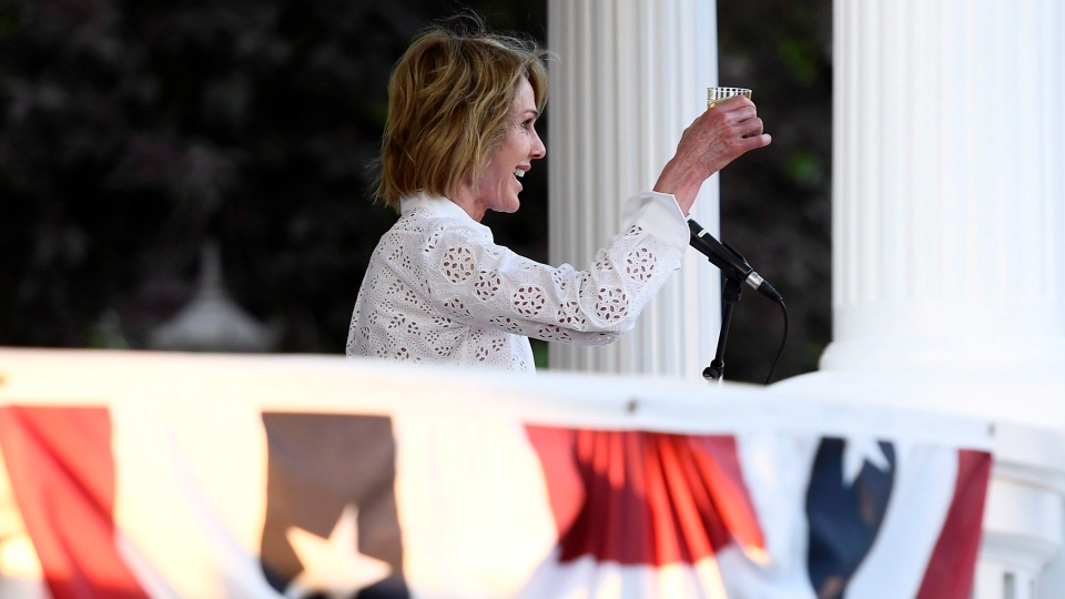 U.S. Ambassador to Canada Kelly Craft raises her glass for a toast during the Fourth of July Independence Day celebration at Lornado, the ambassador's official residence, in Ottawa on Wednesday, July 4, 2018. THE CANADIAN PRESS/Justin Tang