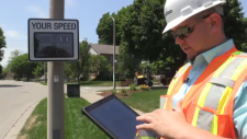 City worker with speed sign