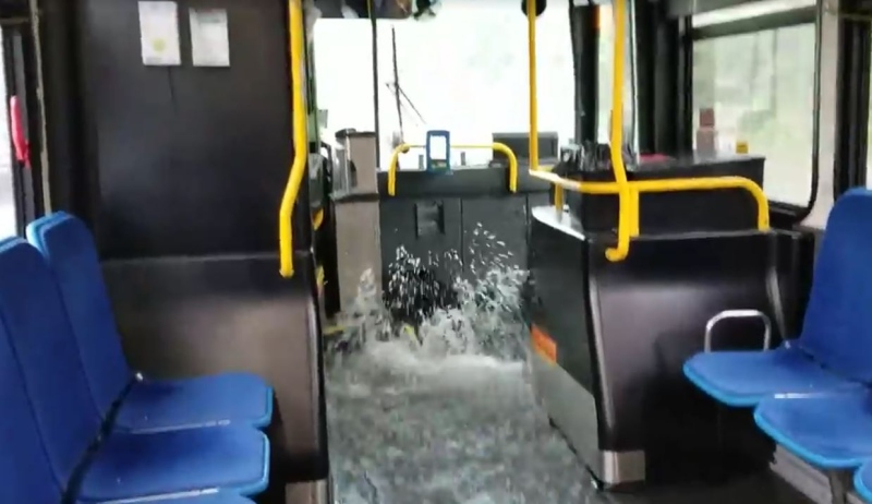Water rushes through an LTC bus due to flooded streets in the area of Oxford Street and Proudfoot Lane on Thursday, July 5, 2018.  (Photo: Amar Ujjani)