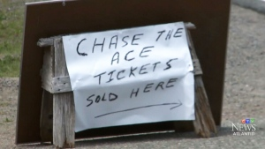 A sign points patrons toward the Chase the Ace draw in Margaree, N.S.