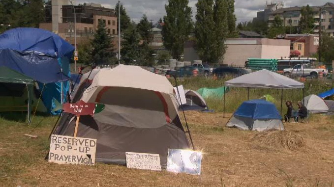 There's been a beefed-up police presence at the encampment at Regina Park, just across the highway from Uptown Mall, since it sprung up in May. July 5, 2018. (CTV Vancouver Island)