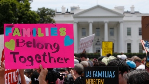 In this June 20, 2018, file photo, activists march past the White House to protest the Trump administration's approach to illegal border crossings and separation of children from immigrant parents in Washington.(AP Photo/Alex Brandon, file)