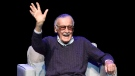 "Comic book writer Stan Lee waves to the audience after being introduced onstage at the ""Extraordinary: Stan Lee"" tribute event at the Saban Theatre on Tuesday, Aug. 22, 2017, in Beverly Hills, Calif. (Photo by Chris Pizzello/Invision/AP)"