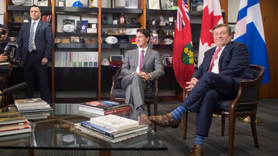 Prime Minister Justin Trudeau and Toronto mayor John Tory pose for the media before their meeting at city hall in Toronto on Friday, July 6, 2018. THE CANADIAN PRESS/Chris Young