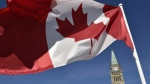 The Canadian flag is seen in front of the Peace Tower on Parliament Hill in Ottawa on October 2, 2017. (THE CANADIAN PRESS/Justin Tang)