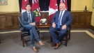 Ontario Premier Doug Ford (right) sits with Canadian Prime Minister Justin Trudeau at the Ontario Legislature, in Toronto on Thursday, July 5, 2018. THE CANADIAN PRESS/Chris Young